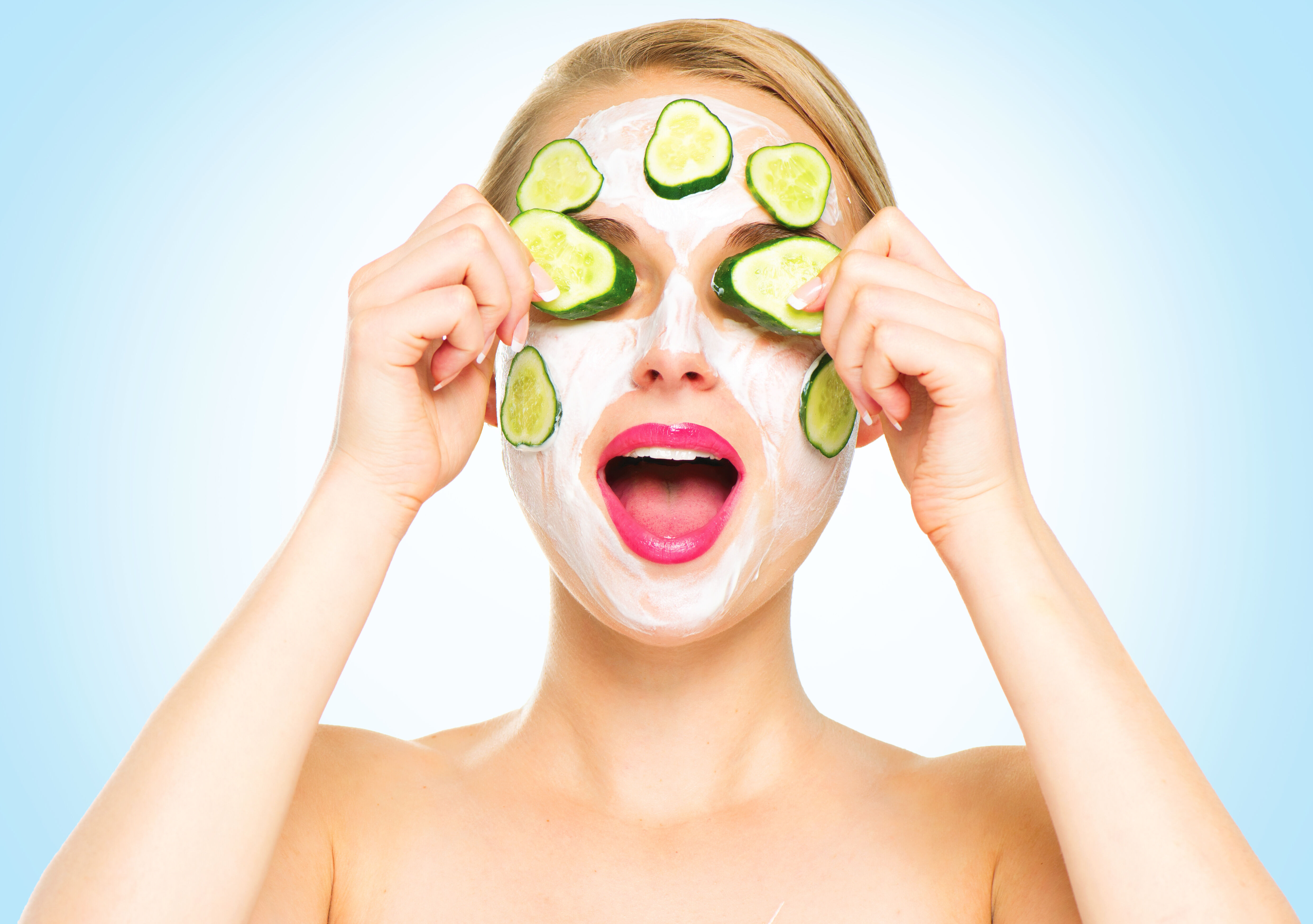 Girl with cucumbers in her eye