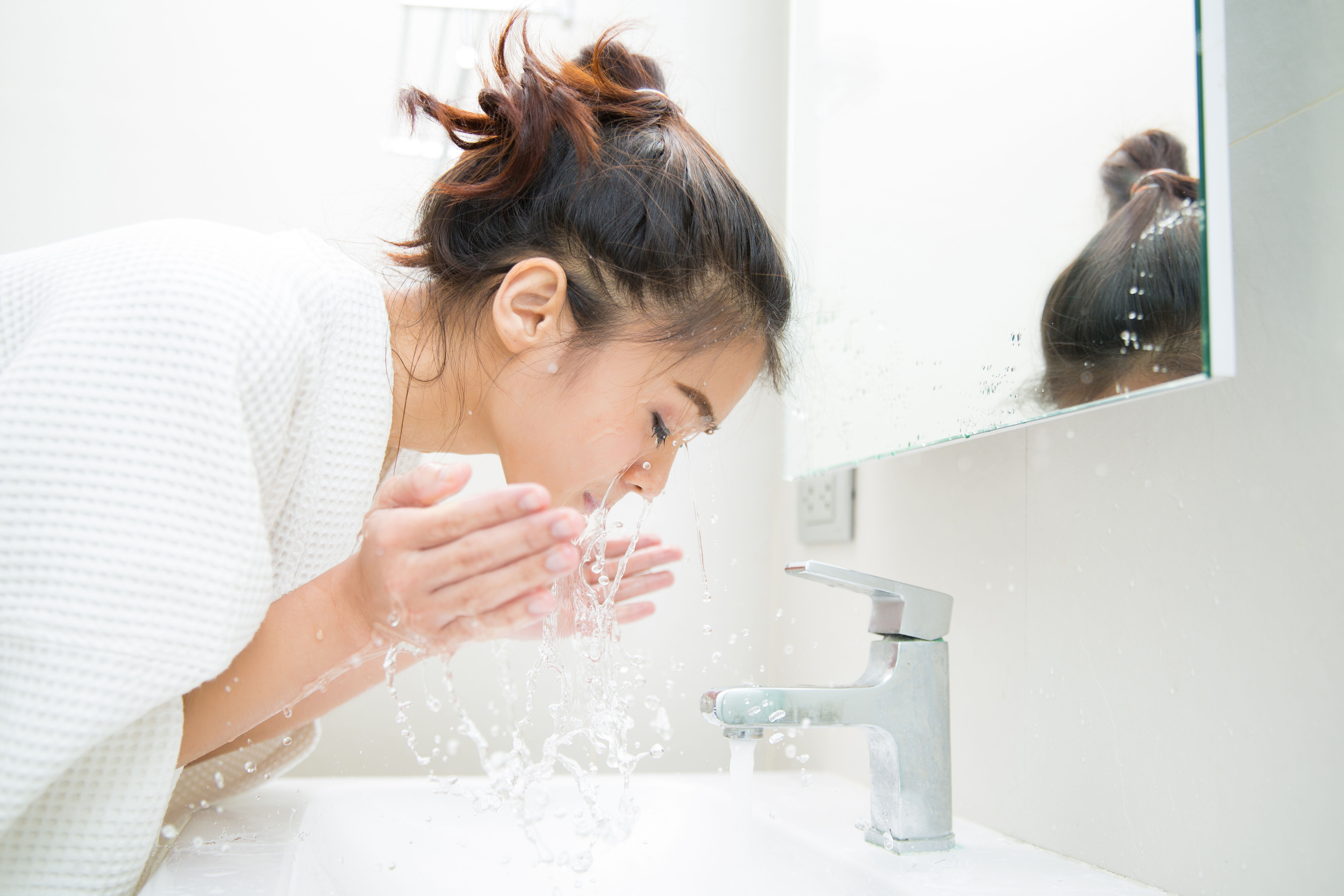 Girl washes the cosmetics off