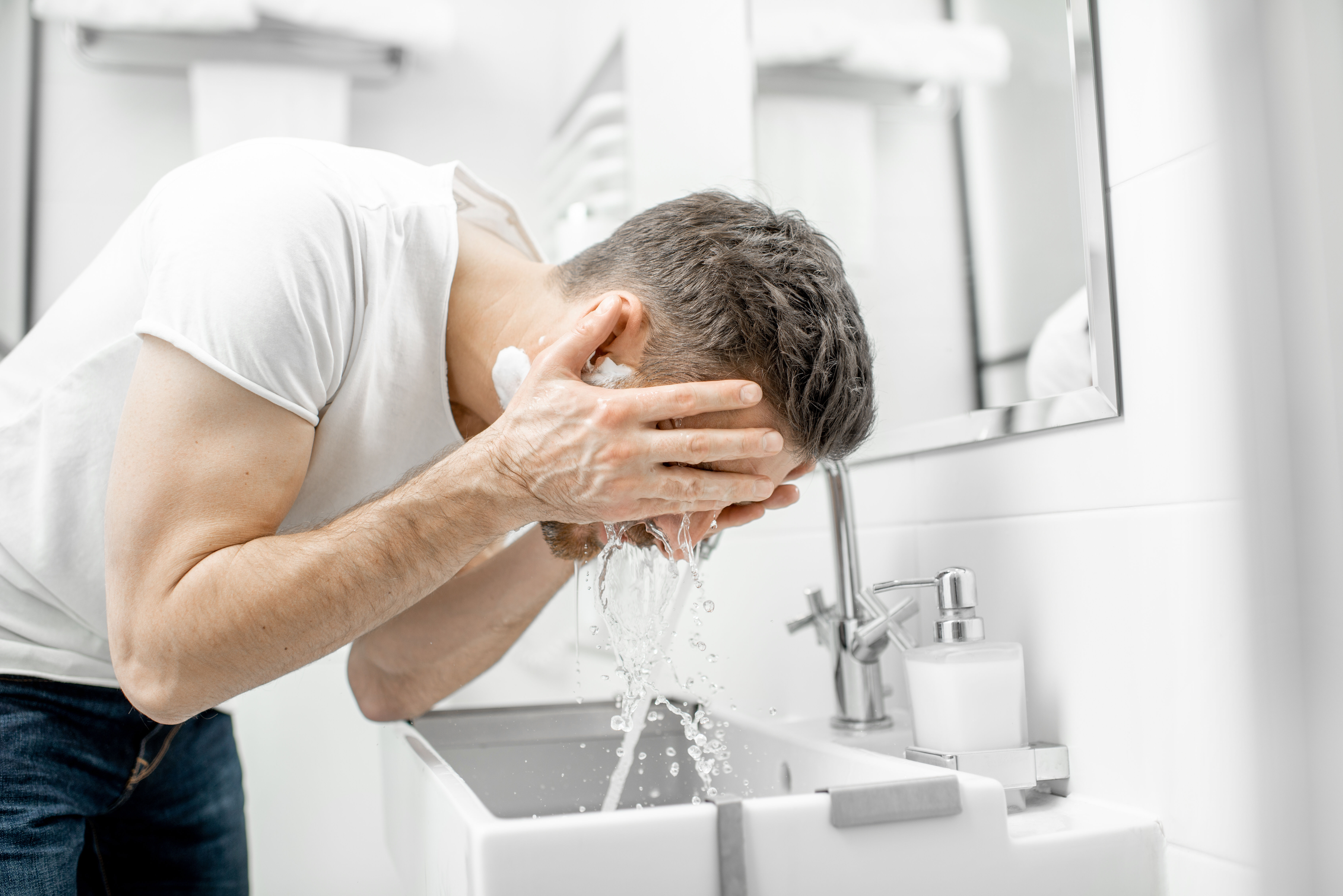 The man is washing his face