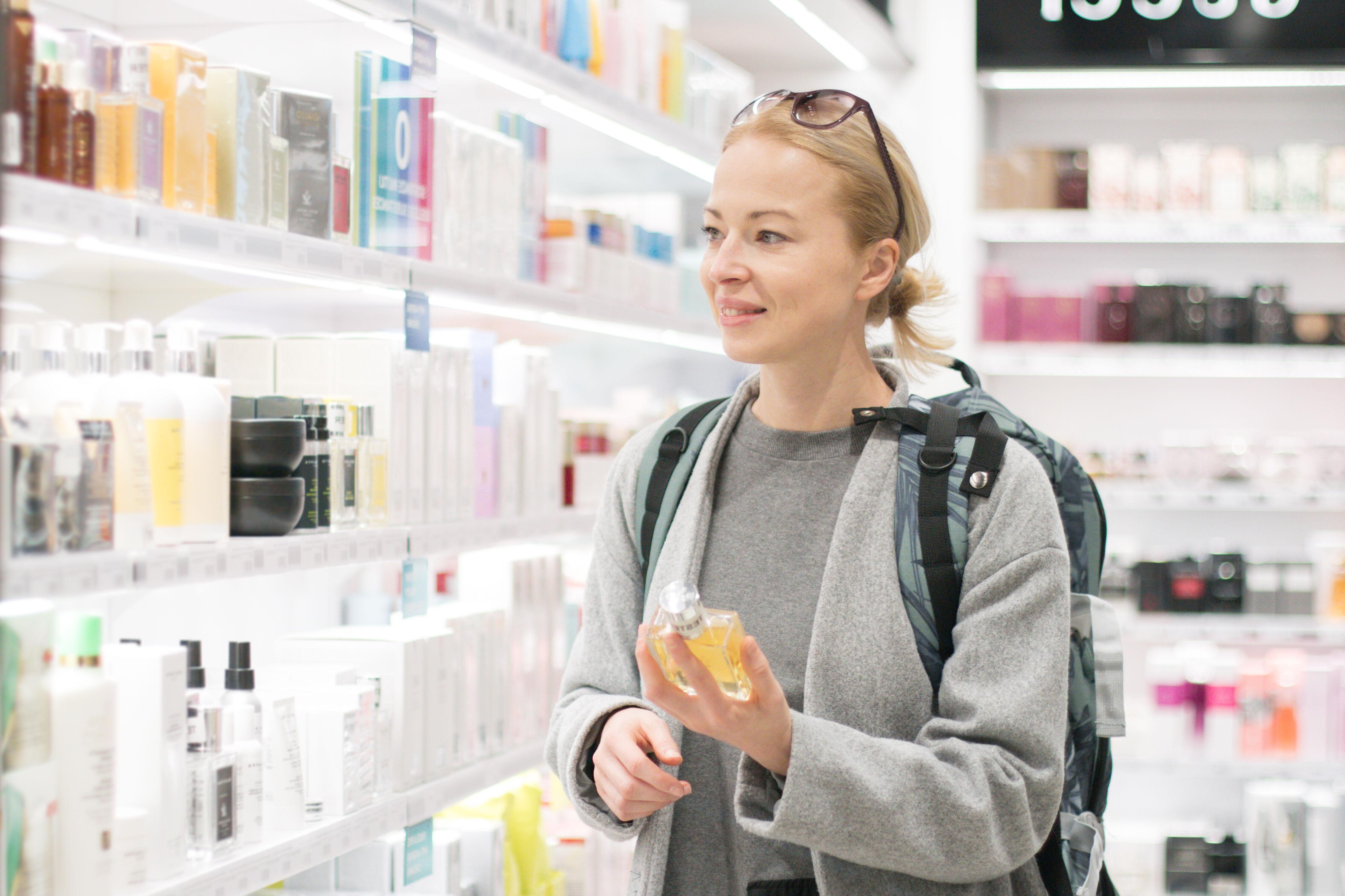 Woman chooses cosmetics