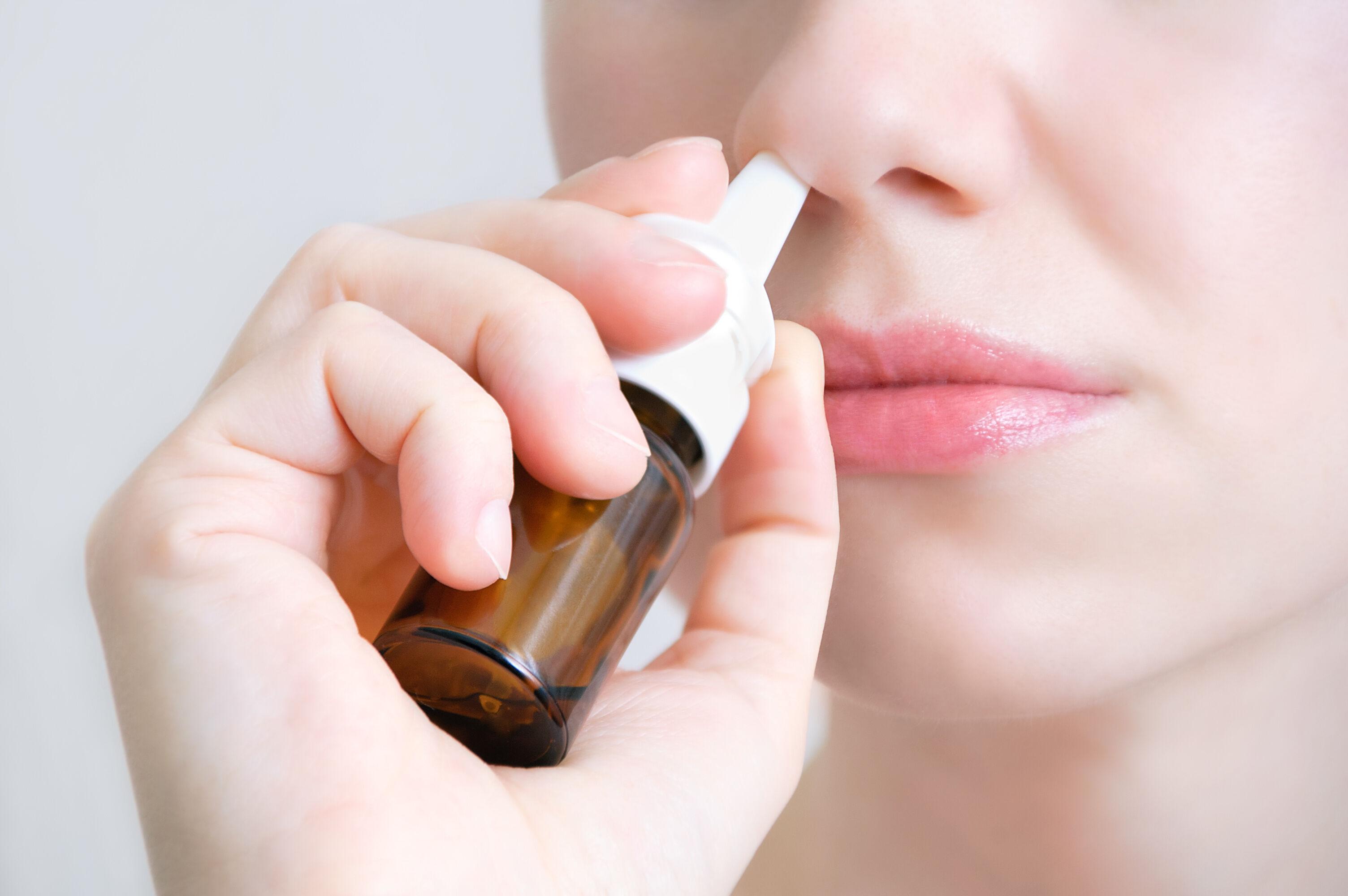 The woman uses nasal drops