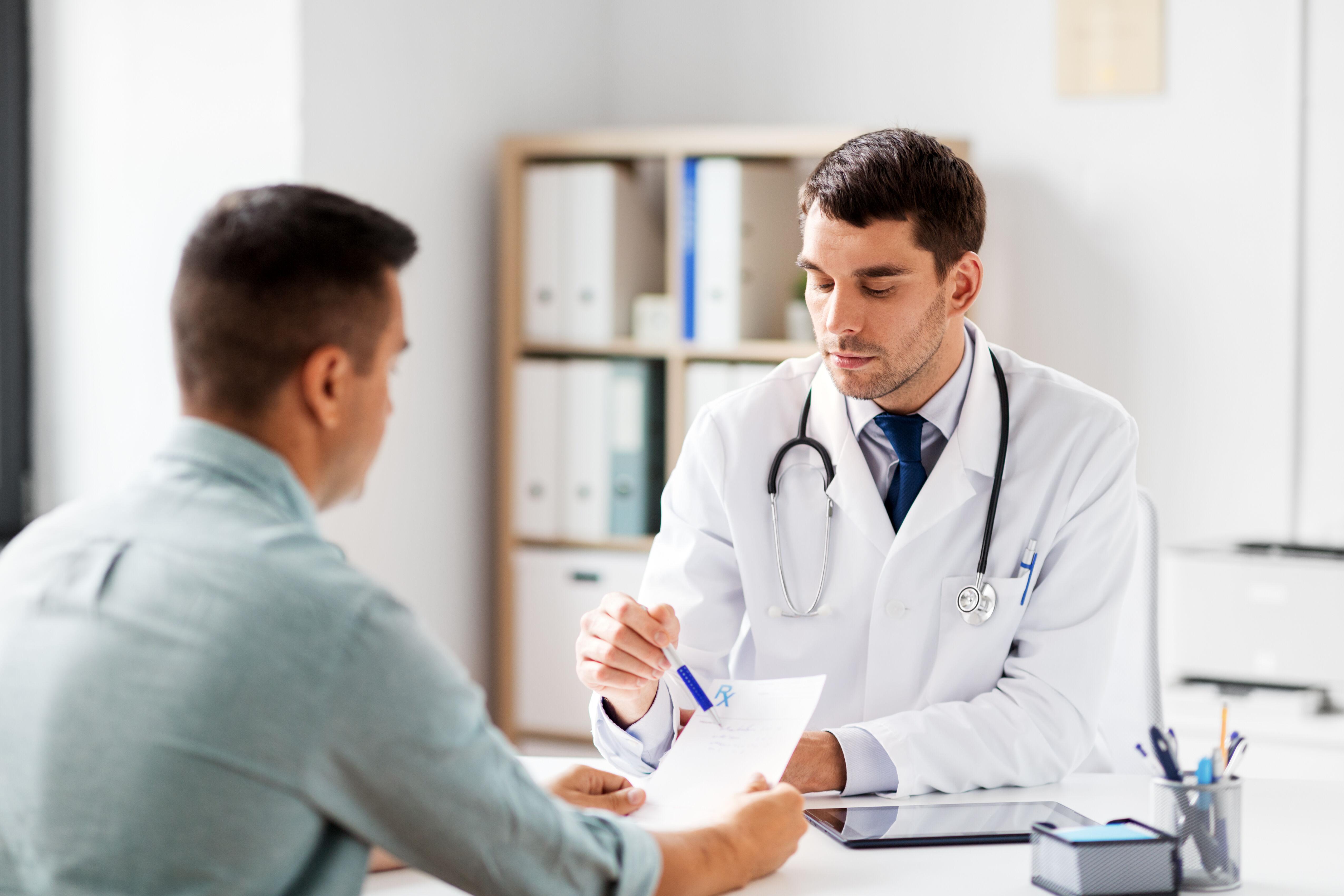 The doctor shows the patient a prescription