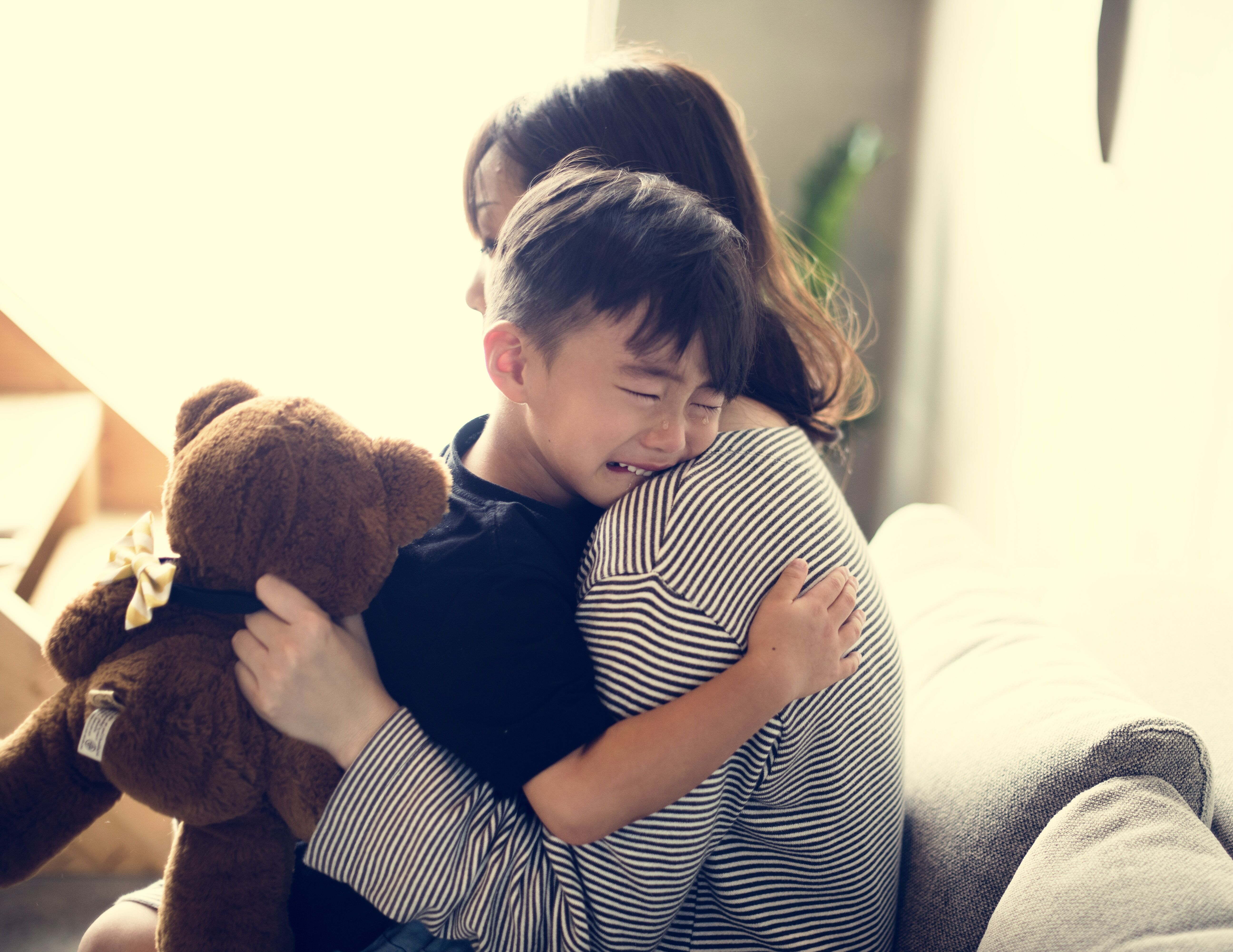 Boy crying near mother